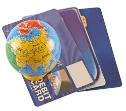 Debit and credit cards with a globe on a white background, suggesting international transactions